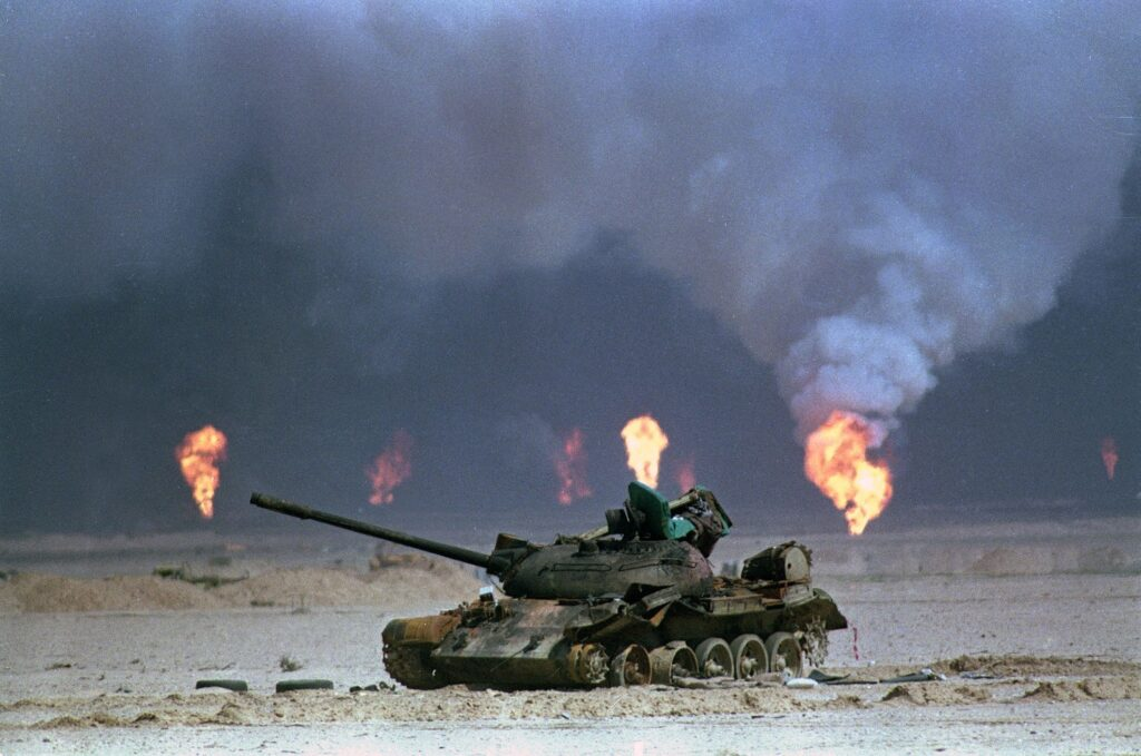 From The Atlantic: A destroyed Iraqi tank rests near a series of oil-well fires during the Gulf War, on March 9, 1991, in northern Kuwait. David Longstreath / AP